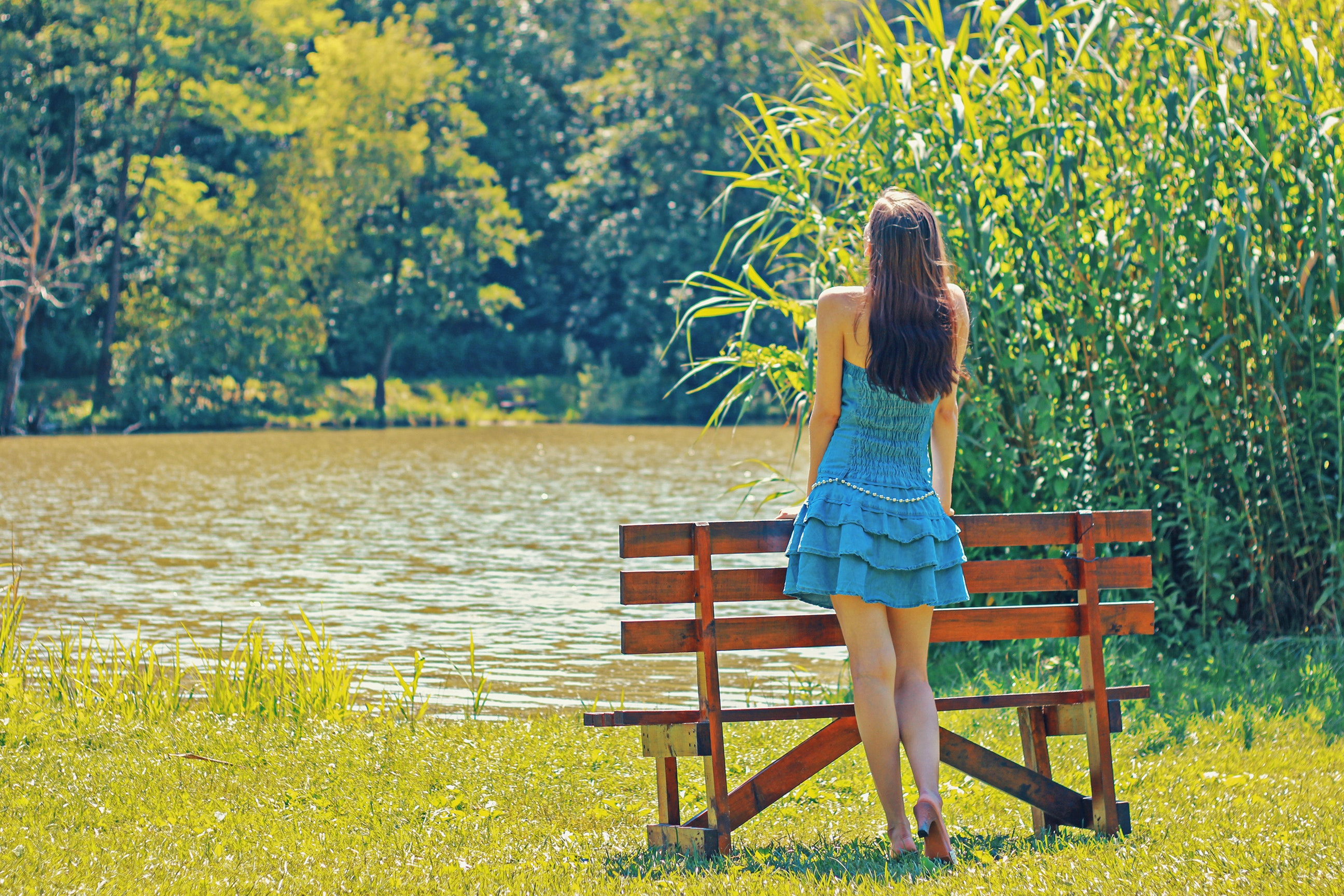 woman looking over a pond