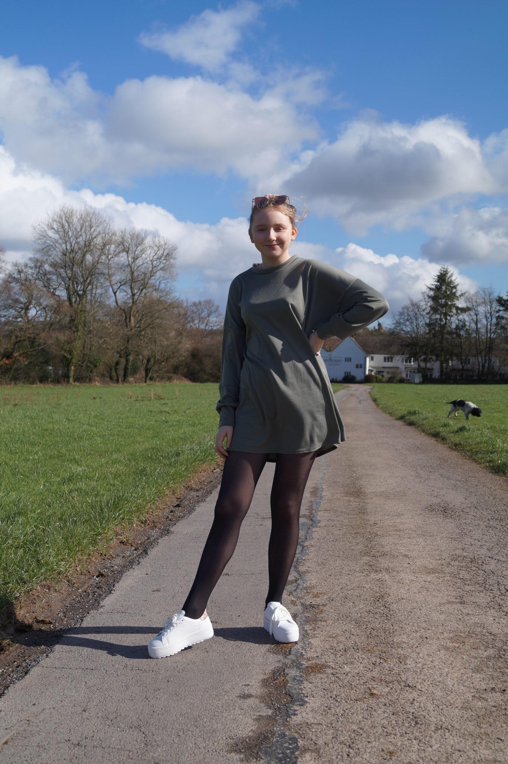 Lissy wearing a jumper dress from Femme Luxe