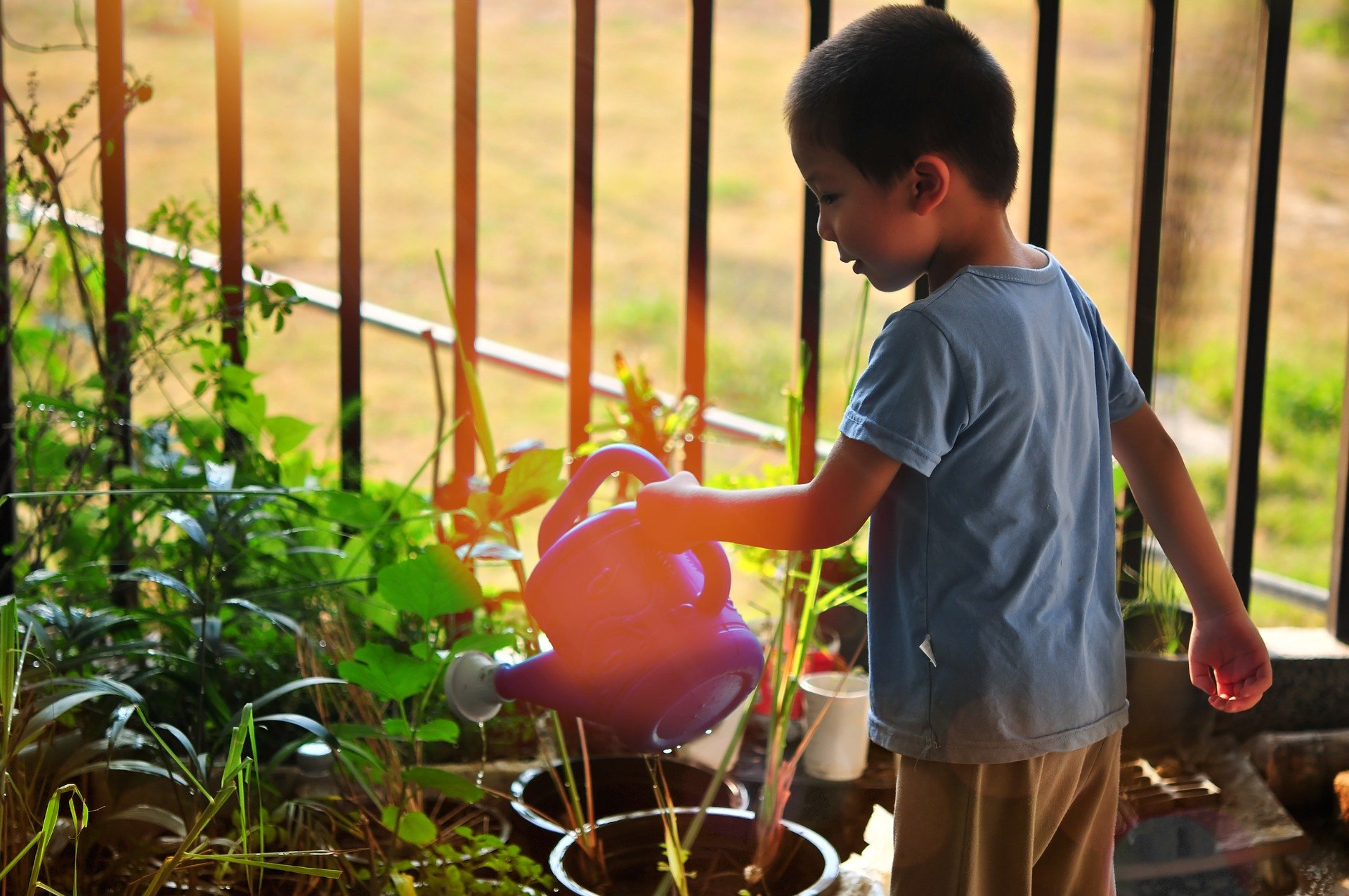 child with a watering can